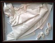 Christening gown in shadowbox.