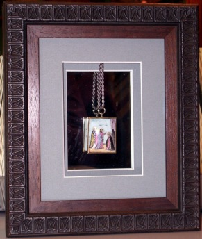 Russian Icon in a shadowbox, freely suspended from a chain in front of a mirror