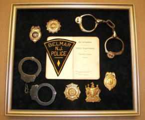 Belmar police shadowbox including antique handcuffs.