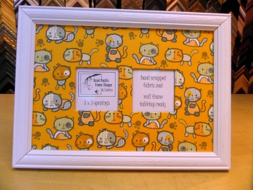 White frame with cat fabric.