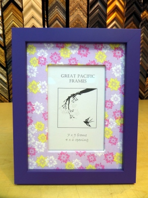 Purple frame with flower fabric.